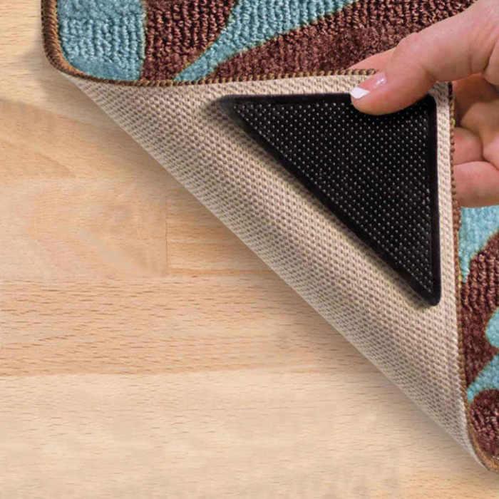 С противоскользящими накладками коврик лежит ровно и не путается под ногами. /Фото: ae01.alicdn.com